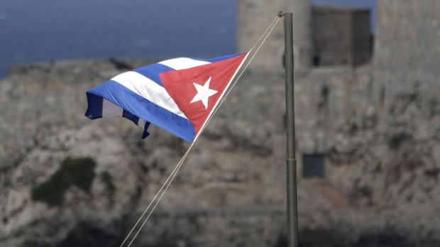A Cuban flag flies in Old Havana, Monday Dec. 5, 2011.