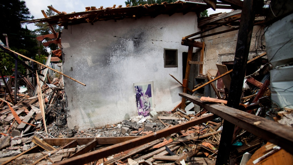 A destroyed house that was hit by a rocket fired by Palestinians militants from Gaza, in Yahud, a Tel Aviv suburb near the airport, central Israel, Tuesday, July 22, 2014. (AP / Dan Balilty)