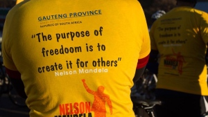"A cyclist wears a t-shirt with a typographical error in the word ""freedom"" during a ""Freedom Ride"", in Johannesburg, South Africa, Sunday, July 20, 2014. (AP / Mark Straw)"