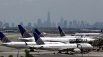 United Airlines jets are parked on the tarmac at Newark Liberty International Airport, Tuesday, July 22, 2014, in Newark, N.J. (AP / Julio Cortez)