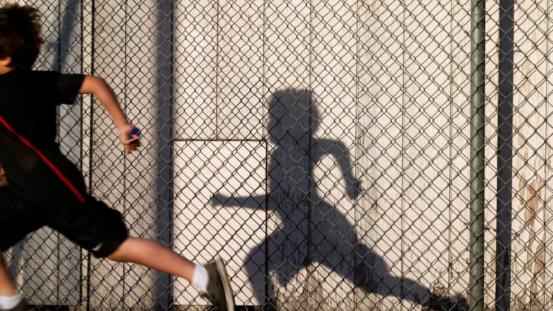 In this March 14, 2014 picture, students take part in an early morning running program at an elementary school in Chula Vista, Calif. (AP / Gregory Bull)