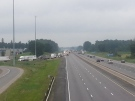 Vehicles are seen being diverted off Highway 401 near Ingersoll, Ont. after an early morning crash involving a car and a motorcycle on Wednesday, July 23, 2014. (Justin Zadorsky / CTV London)