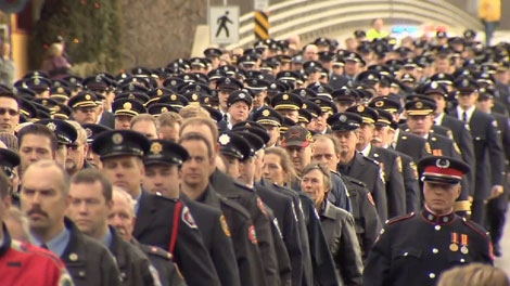 Firefighters march through the small town of Enderby, B.C. during the funeral procession for volunteer Dan Botkin. Jan. 5, 2012. (CTV)