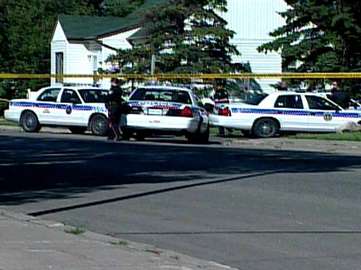 Police investigate the scene after a 34-year-old was shot and wounded by a Regina police officer on Saturday, Aug. 23, 2008.