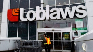 A Loblaws employee brings in shopping carts at a store in Toronto in this 2009 file photo. (Nathan Denette/THE CANADIAN PRESS)