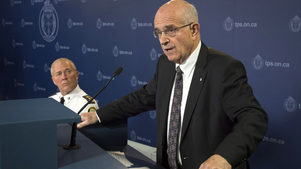 Former Supreme Court of Canada justice Frank Iacobucci, right, speaks about his investigation into the use of lethal force by Toronto police as Toronto Police Chief Bill Blair listens during a press conference at Toronto Police headquarters in Toronto on Thursday, July 24, 2014. (Darren Calabrese / THE CANADIAN PRESS)