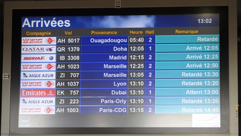 An arrival information screen shows the delayed Air Algerie flight 5017 (top) at the Houari Boumediene airport near Algiers, Algeria, Thursday, July 24, 2014. (AP / Sidali Djarboub)