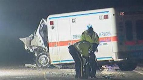 Investigators examine the scene of a collision involving an ambulance near Souris, Man. on Jan. 5, 2012.