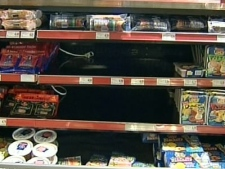 Several shelves at a grocery store sit empty after Maple Leaf Foods issued the largest recall in the company's 100 year history.