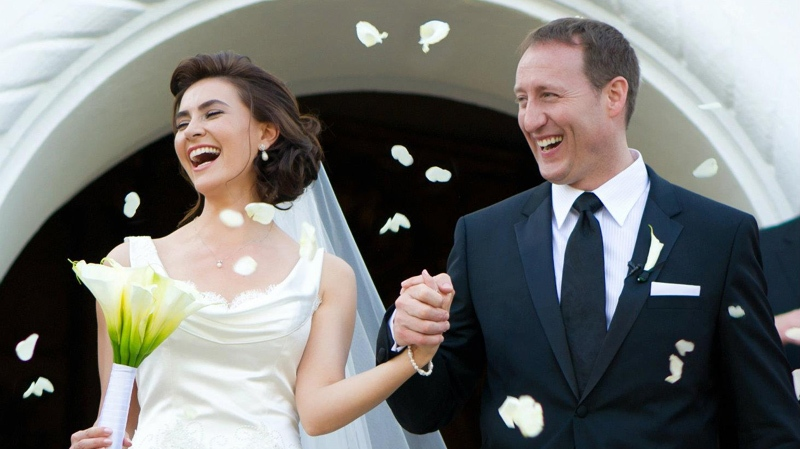 Newly-wed Defence Minister Peter MacKay exits a Mexico wedding chapel with Nazanin Afshin-Jam on Jan. 4, 2012.