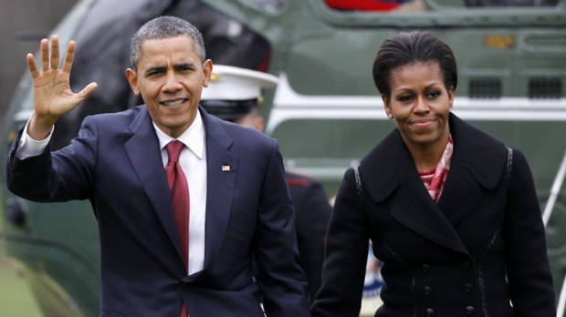 In this Dec. 14, 2011 file photo, President Barack Obama and first lady Michelle Obama arrive on the South Lawn of the White House in Washington.