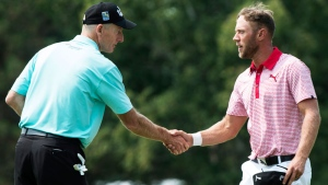 Graham DeLaet, right, from Weyburn, Sask. shakes hands with Jim Furyk of the United States following their round during second round of play at the Canadian Open golf championship in Montreal on Friday, July 25, 2014. (Paul Chiasson / THE CANADIAN PRESS)