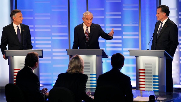 Former Utah Gov. Jon Huntsman, left, and former Massachusetts Gov. Mitt Romney, right, listen to Rep. Ron Paul, R-Texas, answer a question during a Republican presidential candidate debate at Saint Anselm College in Manchester, N.H., Saturday, Jan. 7, 2012. (AP / Elise Amendola)