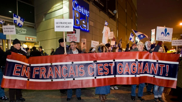 Pro-French language protesters rally outside the Bell Centre during a demonstration denouncing the recent appointment of the unilingual head coach of the Montreal Canadiens hockey team, in Montreal, Saturday, January 7, 2012. (Graham Hughes / THE CANADIAN PRESS)