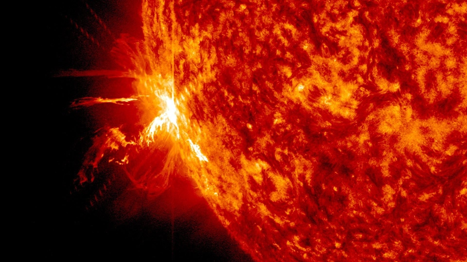 This image provided by NASA's Goddard Space Flight Center shows a significant solar flare erupting on June 10, 2014. (AP / Goddard Space Flight Center)