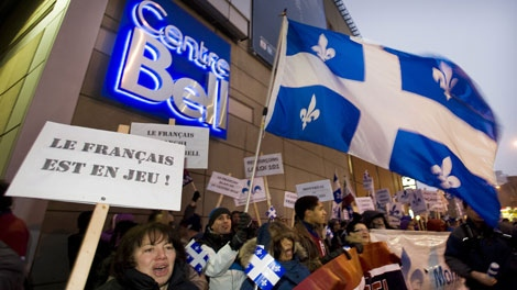 Pro-French language protesters rally outside the Bell Centre in Montreal, Saturday, January 7, 2012, during a demostration denouncing the appointment of the unilingual head coach of the Montreal Canadiens hockey team. THE CANADIAN PRESS/Graham Hughes