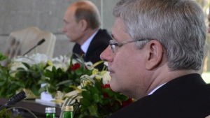 Prime Minister Stephen Harper and Russian President Vladimir Putin in Nusa Dua, Bali, Indonesia on October 7, 2013. (THE CANADIAN PRESS / Sean Kilpatrick)