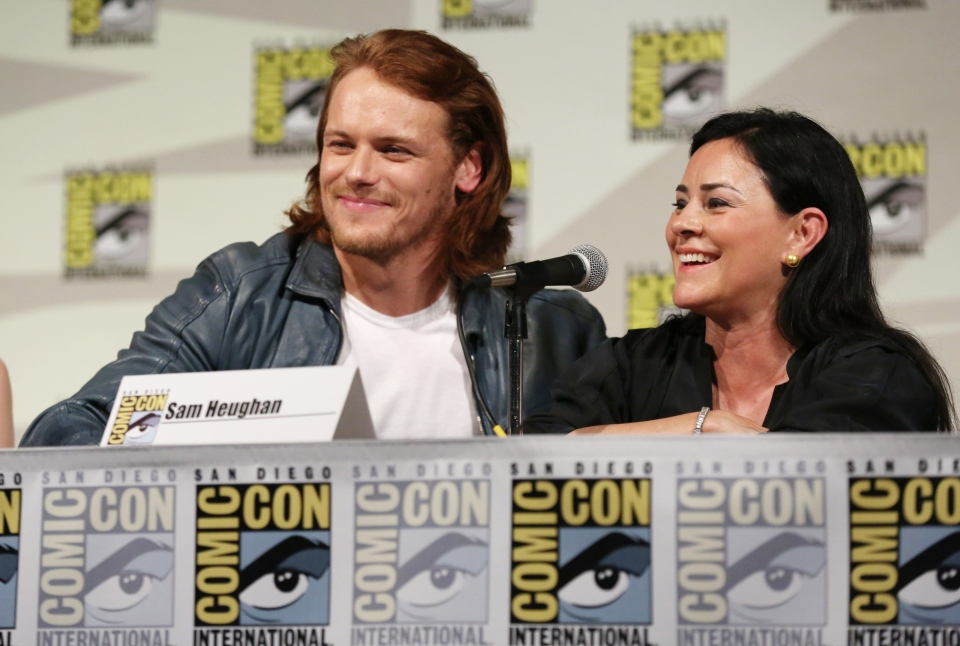 Sam Heughan, left, and Diana Gabaldon are seen onstage at the STARZ 'Outlander' panel during San Diego Comic-Con on Friday, July 25, 2014 in San Diego. (AP / Matt Sayles / Invision for STARZ)