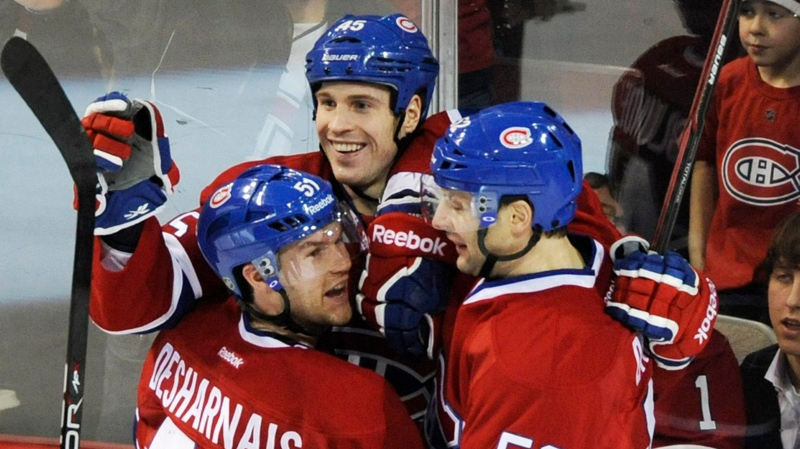 Montreal Canadiens' Mike Blunden, centre, celebrates with teammates David Desharnais (51) and Mathieu Darche (52) after scoring against the Tampa Bay Lightning during second period NHL hockey action in Montreal, Saturday, January 7, 2012. CANADIAN PRESS/Graham Hughes