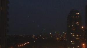 These colourful string of lights in the sky were videotaped on Saturday, July 26, 2014 in the area of Yonge and Sheppard. (Sarah Chun / YouTube)