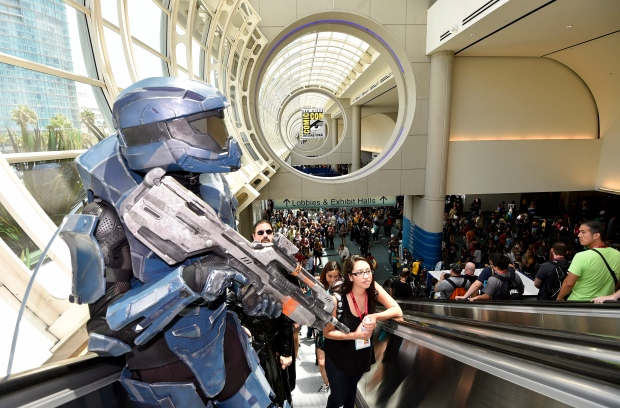 Halo character Connor Sullivan rides on the escalator on Day 3 at the 2014 Comic-Con International Convention held Saturday, July 26, 2014, in San Diego. (AP / Denis Poroy / Invision)