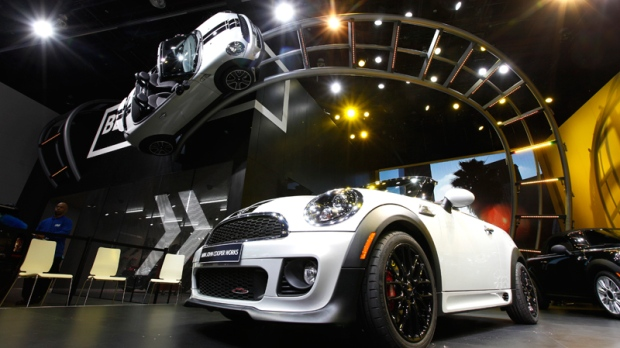 The 2013 Mini Cooper exhibit is displayed at the North American International Auto Show in Detroit, Monday, Jan. 9, 2012. (AP / Paul Sancya)