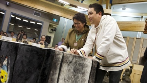 The youngest MLA for Nunavut, David Joanasie, right, with The Commissioner of Nunavut Edna Elias on Nov. 19, 2013. (Peter Power / The Globe and Mail)