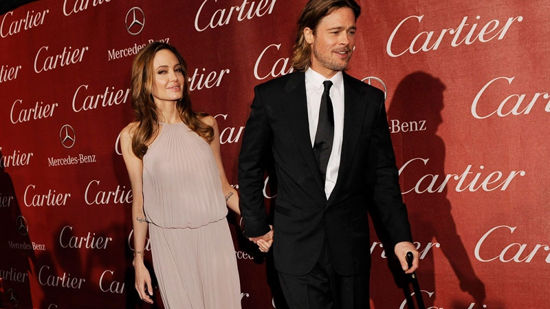 Brad Pitt, recipient of the Desert Palm Achievement Award Actor, arrives with Angelina Jolie at the 2012 Palm Springs International Film Festival Awards Gala, Saturday, Jan. 7, 2012, in Palm Springs, Calif. (AP / Chris Pizzello)