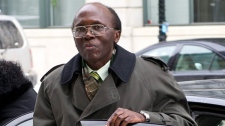 Leon Mugesera, accused of helping incite the Rwandan genocide, arrives at Federal Court Monday, Jan. 9, 2012 in Montreal to seek a judicial review and a delay of his expulsion from Canada. (Paul Chiasson / THE CANADIAN PRESS)