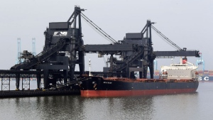 A ship docks at Norfolk Southern's Lamberts Point coal terminal in Norfolk, Va. Over the last six years, as the U.S. has reduced its use of coal, energy companies have sent more coal than ever overseas to meet rising demand. (AP Photo/Patrick Semansky)