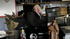 In this December 2011 photo made available by the Science Museum, Professor Stephen Hawking sits in his office at University of Cambridge, in Cambridge, England. (AP / Science Museum, Sarah Lee)