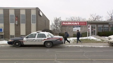 A Waterloo Regional Police Service cruiser is seen outside the Central Pharmasave in Kitchener, Ont. on Monday, Jan. 9, 2012.