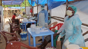 Medical personnel inside a clinic taking care of Ebola patients in the Kenema District on the outskirts of Kenema, Sierra Leone, Sunday, July 27, 2014. (AP / Youssouf Bah)
