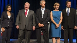 Toronto mayoral candidates from left to right, Olivia Chow, Rob Ford, David Soknacki, Karen Stintz, and John Tory pose following a mayoral debate in Toronto on Tuesday, July 15, 2014. (Darren Calabrese / THE CANADIAN PRESS)