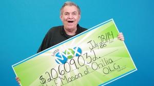 John E. Mason, Orillia's newest millionaire.