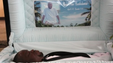 Hundreds of people attended the funeral of Oscar Bartholomew Monday, Jan. 9, 2012 in Crochu, Grenada. (Colin Perkel / THE CANADIAN PRESS)