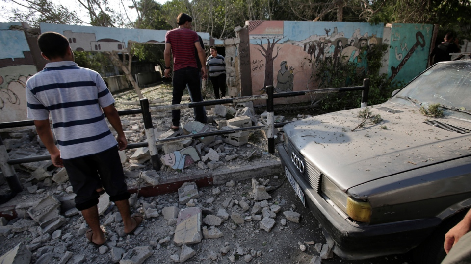 Palestinians search rubble after Israeli airstrike