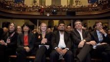 From left, NDP MPs Peggy Nash, Olivia Chow, and candidates Claire Prashaw, Hanif Shaikh, Craig Scott and Justin Duncan listen to speakers during the NDP nomination meeting for the Toronto-Danforth, the former seat of the late Jack Layton, on Monday, January 9, 2012 on Toronto. THE CANADIAN PRESS/Matthew Sherwood