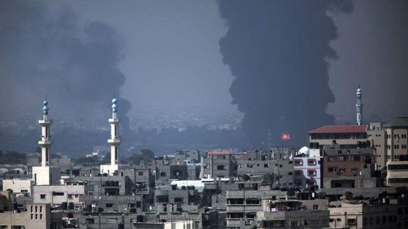 Smoke rises from Gaza's electricity distribution company after it was hit by Israeli strikes in the Nusayrat refugee camp, central Gaza Strip, Tuesday, July 29, 2014. (AP / Khalil Hamra)