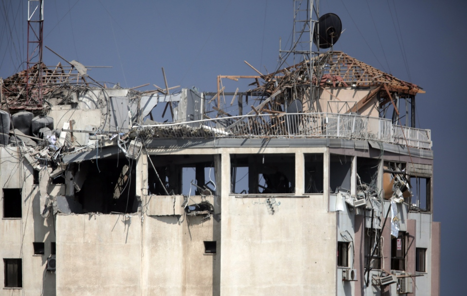 This picture shows the destroyed rooftop of the media complex that houses the offices of Hamas-run Al Aqsa television and radio after it was targeted in an Israeli strike in central Gaza City early on Tuesday, July 29, 2014. (AP / Khalil Hamra)