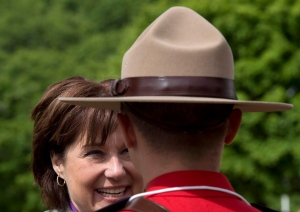 British Columbia Premier Christy Clark greets an RCMP officer as she arrives at an event in Kitimat, B.C., Tuesday, June 17, 2014. (Jonathan Hayward / THE CANADIAN PRESS)