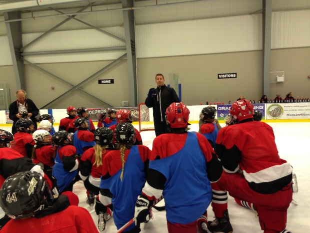 Former NHL star Nick Boynton talks to participants of the Dskate program in this undated image.