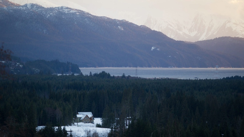 A home is pictured near Douglas Channel, the proposed termination point for an oil pipeline from Alberta in Kitimat, B.C., on Monday January 9, 2012. THE CANADIAN PRESS/Darryl Dyck