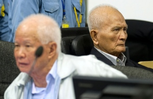 In this Oct. 31, 2013 file photo released by the Extraordinary Chambers in the Courts of Cambodia, Khieu Samphan, left, former Khmer Rouge head of state, and Nuon Chea, right, right-hand man to the group's late chief Pol Pot, sit in the court room of a UN-backed genocide tribunal in Phnom Penh, Cambodia. (AP Photo / Mark Peters)