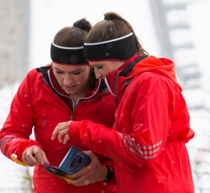 Olympians Natalie Spooner and Meaghan Mikkelson reading a clue at Canada Olympic Park during the first episode of this season of Amazing Race Canada.