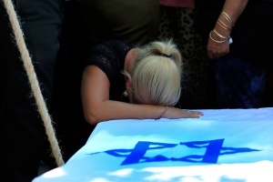 Yulia, the girlfriend of Israeli Staff Sgt. Adi Briga mourns over his coffin during his funeral in the costal city of Ashkelon, Israel, Tuesday, July 29, 2014. (AP / Tsafrir Abayov)