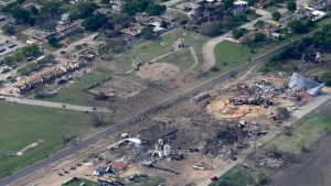 An aerial view of the remains of a fertilizer plant and an apartment complex to the left, destroyed by an explosion in West, Texas, April 18, 2013. (AP / Tony Gutierrez)