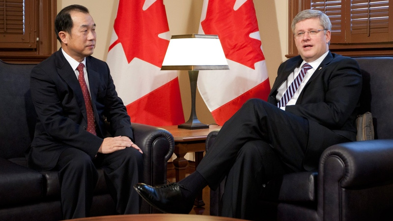 Prime Minister Stephen Harper announces he will visit China in early February as Chinese Ambassador Zhang Junsai looks on at his office in Ottawa Wednesday Jan. 11, 2012. (Adrian Wyld / THE CANADIAN PRESS)