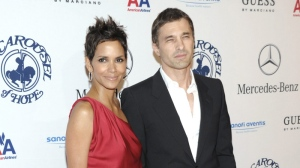 Actress Halle Berry, left, and actor Olivier Martinez arrive at the 32nd Annual Carousel of Hope Ball in Beverly Hills, Calif. on Saturday, Oct. 23, 2010. (AP Photo/Dan Steinberg)