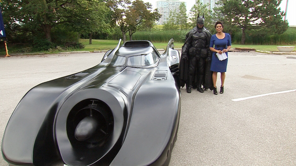 Brampton Batman poses with CTV's Canada AM host Marci Ien in Toronto on Thursday, July 31, 2014.